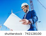 pleased businessman in hardhat... | Shutterstock . vector #742128100