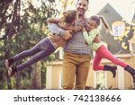 father carrying daughters... | Shutterstock . vector #742138666