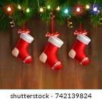three red christmas stockings... | Shutterstock .eps vector #742139824