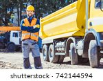 smiling worker in reflective... | Shutterstock . vector #742144594