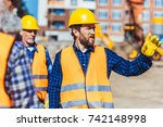 builders discussing work while...   Shutterstock . vector #742148998