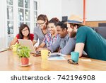 young team with computer in... | Shutterstock . vector #742196908