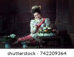 asia woman in thai dress... | Shutterstock . vector #742209364
