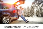 winter car trip and two lovers  | Shutterstock . vector #742210399
