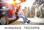 winter car trip and two lovers  | Shutterstock . vector #742210546