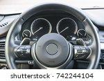 close up of steering wheel. car ...   Shutterstock . vector #742244104