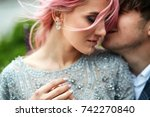 woman with pink hair leans to... | Shutterstock . vector #742270840