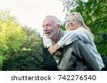 Happy Senior Couple Smiling...