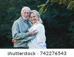 happy senior couple smiling... | Shutterstock . vector #742276543