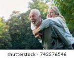 happy senior couple smiling... | Shutterstock . vector #742276546