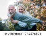 happy senior couple smiling... | Shutterstock . vector #742276576