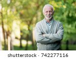 elderly man smiling outdoors in ... | Shutterstock . vector #742277116