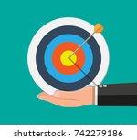 hand of businessman hold target ... | Shutterstock .eps vector #742279186