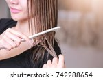 Woman With A Comb In Her Hand...