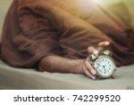 a man lying under a brown... | Shutterstock . vector #742299520