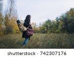 young beautiful girl tourist ... | Shutterstock . vector #742307176