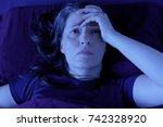 middle aged woman lying awake... | Shutterstock . vector #742328920
