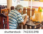 back  behind of old man sitting ... | Shutterstock . vector #742331398