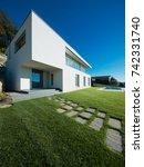 modern white villa with garden | Shutterstock . vector #742331740
