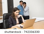 two workers gossip the lady... | Shutterstock . vector #742336330