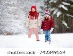 two adorable little girls... | Shutterstock . vector #742349524