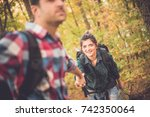 man and woman walking up the... | Shutterstock . vector #742350064