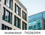 modern apartment complexes next ... | Shutterstock . vector #742362454