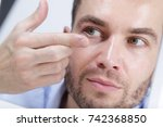 close up of young man holding...   Shutterstock . vector #742368850