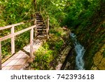 wooden path and waterfall in... | Shutterstock . vector #742393618