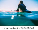surfer woman is relax on... | Shutterstock . vector #742423864