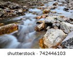 small river with water flowing... | Shutterstock . vector #742446103