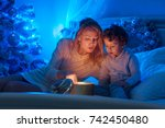 young mother and her son are... | Shutterstock . vector #742450480