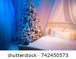 christmas tree in the bedroom.... | Shutterstock . vector #742450573