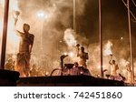 Small photo of October 13,2017. Ganga aarti ceremony performed by young priests at Dashashwamedh Ganges river Ghat Varanasi,Utter Pradesh, India. Selective focus is used.