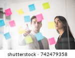 two businesspeople discussing... | Shutterstock . vector #742479358