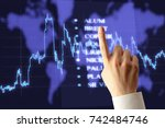 candlestick chart and pointing... | Shutterstock . vector #742484746