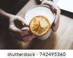 cup of coffee in hands on the...   Shutterstock . vector #742495360