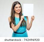 smiling woman wearing dress... | Shutterstock . vector #742496920