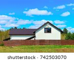 modern cottage house with fence ... | Shutterstock . vector #742503070