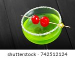 green alcoholic cocktail with... | Shutterstock . vector #742512124