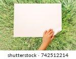child's hand turning over sheet ... | Shutterstock . vector #742512214