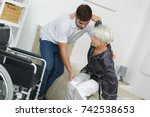 home caregiver helping senior...   Shutterstock . vector #742538653