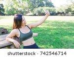 fitness woman taking selfie | Shutterstock . vector #742546714