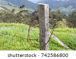 rusty barbed wire fence post in ... | Shutterstock . vector #742586800