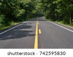 the small rural asphalted curve ... | Shutterstock . vector #742595830