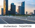 empty urban road and modern...   Shutterstock . vector #742609558