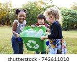 group of kids school volunteer... | Shutterstock . vector #742611010