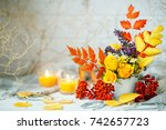 Autumn Leaves And Flowers On A...