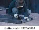 the welder cooks the frame. the ... | Shutterstock . vector #742663804