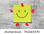 wooden background with a smile... | Shutterstock . vector #742665370